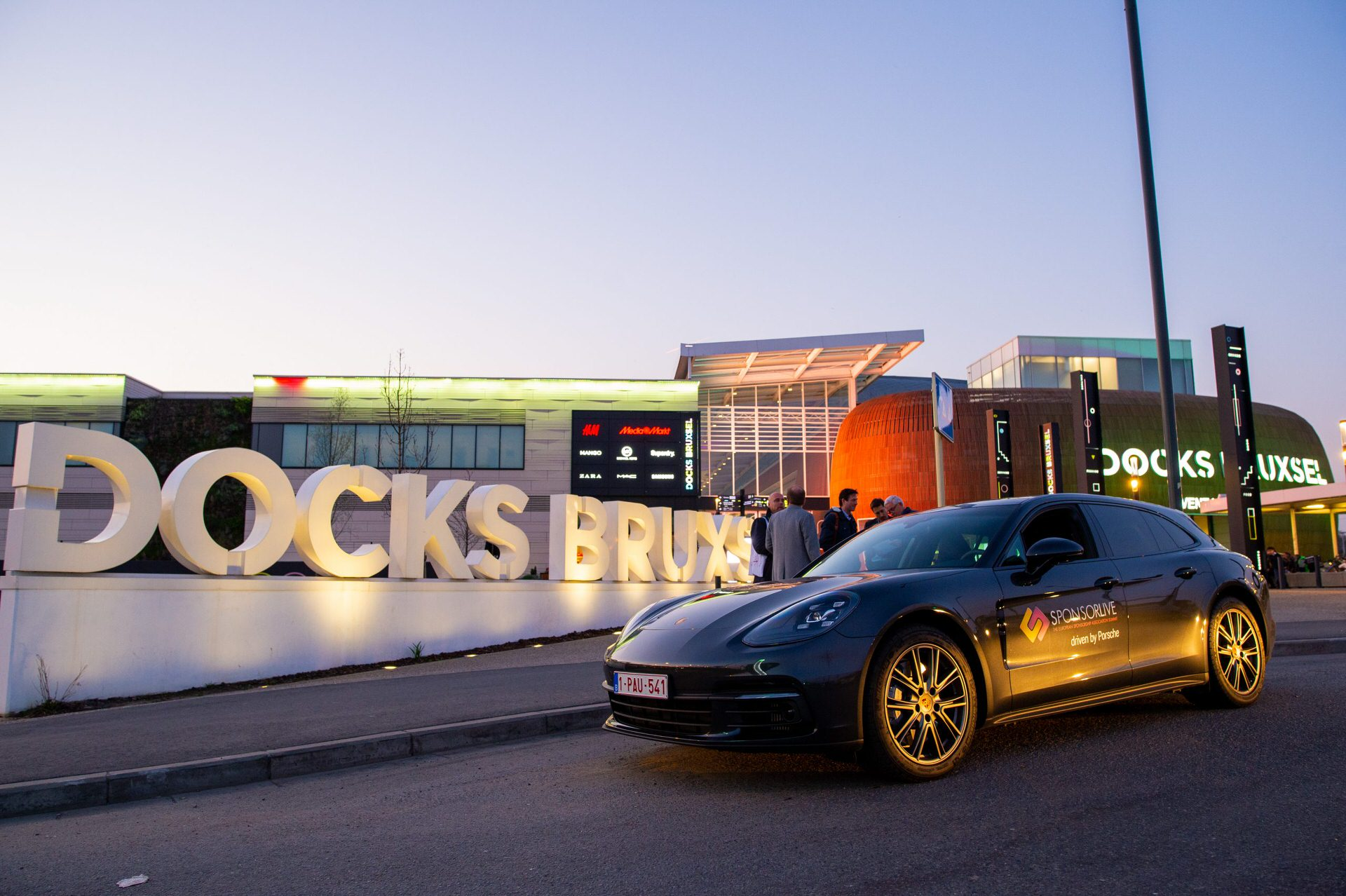 Night view of Docks Drome Brussels with Porsche courtesy car